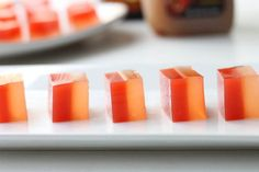 Apple Cider and Buttered Rum Jello Shots - Halloween - Autumn/ Fall - square pan, unflavored gelatin, red food coloring, apple cider, butterscotch schnapps, light rum.