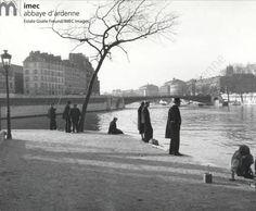 """Fishermen of quai Bourbon (Ile St. Louis) - on extreme right """"L'Hotel de Ville"""" - to the left Ile de la Cite - Paris 1932 Gisèle Freund 1928-1964"""