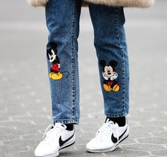 c949c314cc5 Wearing Disney is always in style! The streets of Fashion Week included  some of our favorite characters.