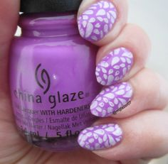 """This is three coats of """"That's Shore Bright,"""" from China Glaze's Summer 2013 Sunsational Collection. I then used Sinful Colors' """"Snow Me White"""" to stamp an image from Cici & Sisi's plate 02 from their white set of plates."""