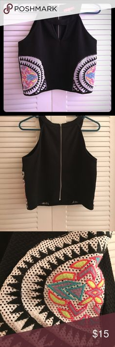 Super Cute Black crop top with neon accents Super Cute black crop top with neon accents on the sides and key hold neckline. The back has a full length zipper. This is a great top to wear with jeans, high waisted shorts/pants, maxi skirts, etc. Tops Crop Tops