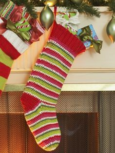 Free Pattern - This bright and fun #crochet stocking looks even better filled with Christmas goodies! #christmas #holidays