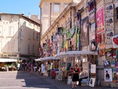 Avignon, France - July 11th, 2012: Plenty of playbills on a wall in Avignon during famous theatre festival Stock Photo