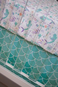 Browsing for girl nursery themes? This mermaid crib bedding is one of our top sellers! We love the mix of purple, mint and turquoise for your nautical baby nursery.