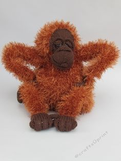 Orangutan Soft Toy Knitting Pattern by Susan Cowper The Orangutan soft toy knitting pattern makes a super cute Orangutan plush teddy character perfect for ape lovers and a great to make for your little monkeys.The Orangutan is knitted with Stylecraft Special DK yarn and King Cole Moments yarn which gives that lovely hairy look.The knitted toy is about 22cm tall and about 25cm wide. She is fixed in