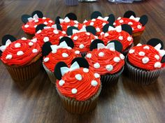 Our finished Minnie Mouse inspired cupcakes for a birthday. We used black fondant circles for the ears and white fondant for the bows.