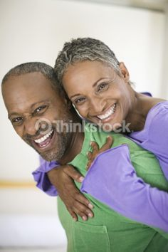 Middle aged couple hugging and smiling