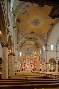 Saint Josaphat, interior view with altar, early speaking platform, ornate chandelier, and transept.