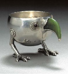 A jewelled gold and silver mounted Charka Bowl shaped as a Bird marked Fabergé and with the workmaster's mark of Anna Ringe, St. Petersburg, circa 1896, with scratched inventory number 2661.  Of rounded form, with gold-mounted cabochon red stone eyes, nephrite beak and claw feet, engraved with the Russian inscription 'Christmas Tree, 4 January 1897', marked on the reverse 2in. (5.1cm.) high