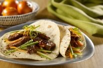 These Asian-inspired chopped steak tacos are served with a cucumber and carrot slaw in ginger, soy and orange dressing. Veal Recipes, Asian Recipes, Mexican Food Recipes, Cooking Recipes, Tortilla Recipes, Yummy Recipes, Asian Tacos, Korean Tacos, Tasty Tacos Recipe