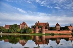 Castle of the Teutonic Order in Malbork The Castle of the Teutonic Order in Malbork (Polish: zamek w Malborku; German: Ordensburg Marienburg), located in the Polish town of Malbork, is the largest castle in. Chateau Medieval, Medieval Castle, Facts About Castles, Malbork Castle, Empire Romain, Small Group Tours, Small Groups, Fairytale Castle, Saint Michel