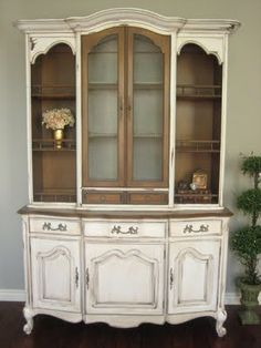 Solid pecan wood, French Provincial hutch. High end quality by the makers of White Fine Furniture Co. Mebane, North Carolina.  Antiqued ivory white finish. Distressed with a creamy glaze.