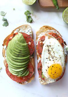 Ultimate California Toast | Sourdough toast topped with serrano pepper + cilantro cream cheese, garlic roasted tomatoes, avocado and a fried egg | EatStyleCreate.com