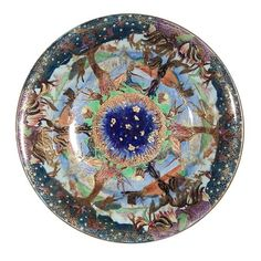 Wedgwood Fairyland lustre bowl, designed by Daisy Mekeig-Jones, interior- 'Elves On A Branch' pattern, exterior- mottled green blue glaze with gilt bird motif, Portland vase mark. 9'' dia., 1 3/4''h
