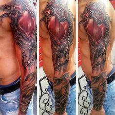 Biomechanical Sleeve Tattoo - http://giantfreakintattoo.com/biomechanical-sleeve-tattoo/