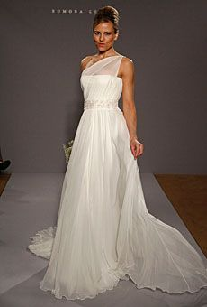 Brides.com: Summer Wedding Gowns from the Runways. Romona Keveza  Silk chiffon gown with one-shoulder illusion neckline, flowing chapel train and Swarovski crystal beaded belt at the waist. Style RK125, Romona Keveza
