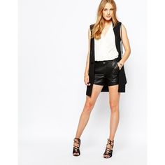Vila Leather Look Shorts (46 CHF) ❤ liked on Polyvore featuring shorts, black, black shorts, black stretch shorts, black cuffed shorts, tall shorts and black stretchy shorts