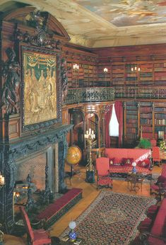 The two-tier, walnut-paneled library at Biltmore House contains some 10,000 volumes and a fireplace surrounded by a carved, black-marble mantel. On the second floor of the library, there is a secret door that George Vanderbilt used to come down directly from his bedroom to locate or return a book.