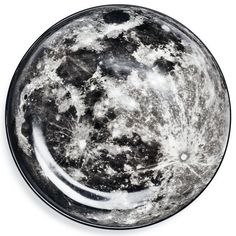 Moon Plate by Diesel by Seletti Part of the Cosmic Diner collection of out-of-this-world dinnerware, the moon plate is made of porcelain and decorated with a realistic image of Earth's one and only.