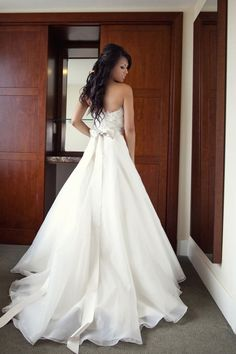 One of the prettiest, flowing wedding dresses! And I LOVE the long ribbon bow! This would be Gorgeous!