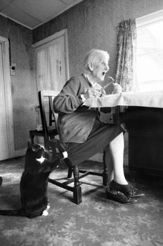 Elderly woman with begging cat
