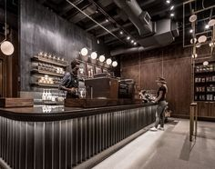 Visit some of Starbucks most distinctive locations, from the sandy beaches of the Caribbean to the bright lights of Las Vegas. Bakery Interior, Restaurant Interior Design, Coffee Shop Design, Cafe Design, Cafe Bar, Cafe Restaurant, Starbucks Store, Starbucks Reserve, Bright Lights