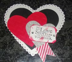 Happy Valentine's Day using Stampin' Up! framelits, cardstock and stamps. Lots of hearts tell that special someone you really love them. Visit my blog for more information and a link to order the items to make this for yourself.