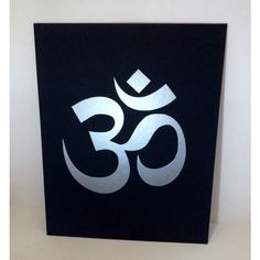 Ohm Print on Canvas Panel Wall Art, Aum Sign, Ohm Symbol Art, Yoga... ($14) ❤ liked on Polyvore featuring home, home decor, wall art, black wall art, canvas signs, silver home decor, black panel and black canvas wall art