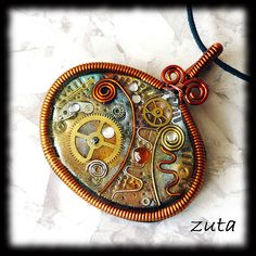 Pendant by Verundela, via Flickr  on Polymer Arts Blog today- there are pages and pages of inspiration