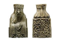 Looking rather glum, the queen cradles her chin with her right hand while her left hand clasps a drinking horn. The back of the piece (pictured right) shows the queen is wearing a veil beneath her crown, which covers her hair, and is sitting on a throne decorated with a foliage design.