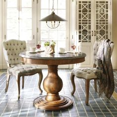 Tuck a bistro table in your kitchen with a few petite tufted seats. Available @Arhaus