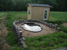 Duck pond on hill with drain. Attach hose and fertilize plants. Seems like a lot of water use, though!