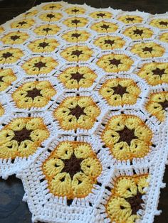 Unique Sunflower girl's blanket using the African Flower crochet pattern.  The cute little picots on the edge give it some flair!