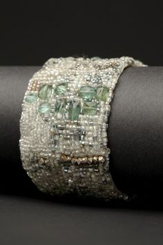 """Aqua Klimt Couture Cuff. $1400. Aquamarines, vintage glass seed beads, pearls, vintage metal seed beads and Thai silver hand embroidered on heavy silk with a hammered-silver clasp.  Width: 1 1/2"""""""