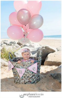 A little one in a basket is a perfect photo option for a one year old.  See more first girl birthday party ideas at www.one-stop-party-ideas.com