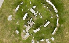 Archaeologists can now say for certain that Stonehenge was once a complete   circle after the dry weather revealed the ghostly outlines of missing stones