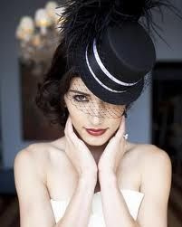 If I could have found this in white for my wedding.  I wore a pillbox style hat with veil attached and my husband wore a black top hat.