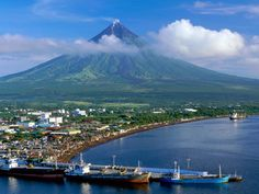 """Mayon Volcano, also known as Mount Mayon, is an active volcano in the province of Albay, on the island of Luzon in the Philippines. Renowned as the """"perfect cone"""" because of its almost symmetric conical shape Voyage Philippines, Philippines Tourism, Les Philippines, Philippines Culture, Manila, Volcan Eruption, Mindanao, Tourist Spots, Vacation Spots"""