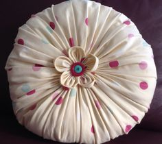 Hand made round cushion with fabric flower centre