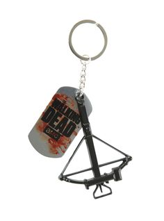 Key chain with a The Walking Dead dog tag and a crossbow.