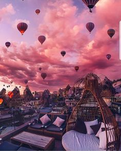Relaxing with beautiful view of hot air balloons. Travel bucket list ideas for couples.