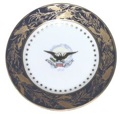 Of all the White House china patterns to date, there are few more celebrated than that of President and Mrs. Benjamin Harrison. Caroline Harrison had once taught china painting to young ladies in Indianapolis. Thus, she chose to personally design the pattern for her White House china: an American Eagle motif at the center and a border design of open corn ears combining cobalt blue and gold. An inner border represents each of the existing American states at that time with 44 gold stars.