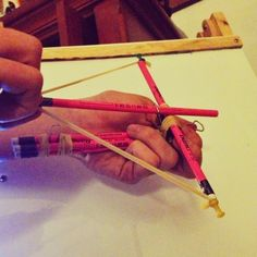 Crossbow made with pencils pushpins, rubber bands, paperclip & a binder clip. It really works too!!   With as much as my son goofs off in class you'd never know he was an honor student, LOL!!