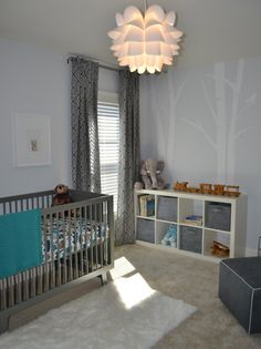 Modern, yet whimsical nursery. I love the use of greys, white & splashes of blue for the color palette.