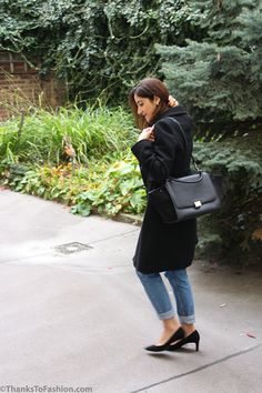 Classic black wool coat styled with a pair of Topshop high wasted mom jeans , black silk shirt and a trapeze Celine bag