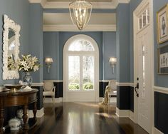 An inviting entry way brings in harmonious blues and white trim, plus lots of natural light.