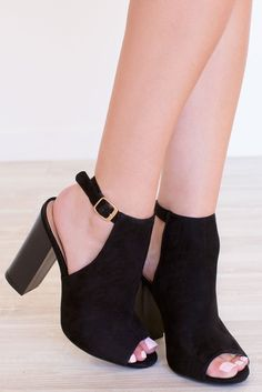 """It'll be good for ya! Our black Back For Good Heelsfeature a faux suede material, open-toe styling andopen back with adjustable ankle strap.Stacked block heel. Gold hardware.Cushioned insole and rubber bottom sole with non-skid markings.*Man Made Materials*Shoe Height: 8""""*Heel Height: 4.5""""*Imported"""