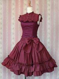 Victorian Maiden. This is gorgeous! I love the beautiful bib and the details on it. And this is a drop waist style dress; that is quite unique for I don't see it very often. Very pretty!