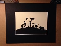 This is a silhouette of Winnie the Pooh and Friends. The picture itself is 5x7 drawn in black ink on a cream colored card stock and mounted