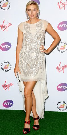 WHAT SHE WORE Maria Sharapova sported an embroidered Antonio Berardi cocktail dress, velvet Roger Vivier sandals, jewelry by Amrapali and a white Alexander McQueen clutch at a Wimbledon bash. WHY WE LOVE IT The tennis player hit it out of the court in a leg-baring asymmetrical number.